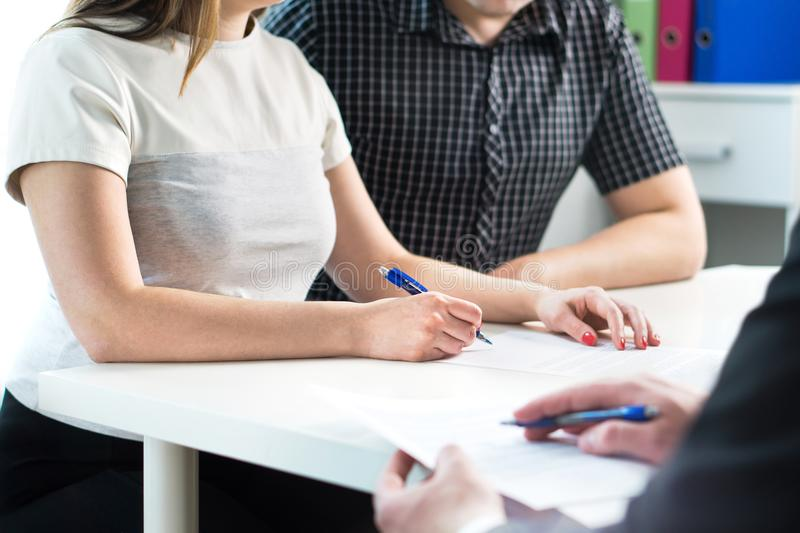 Couple signing contract. Legal document, health insurance. royalty free stock photography