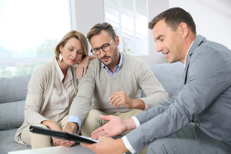Couple signing mortgage contract royalty free stock image