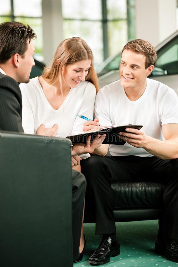 Download Couple Signing Sales Contract At Car Dealer Stock Photography - Image: 15210522