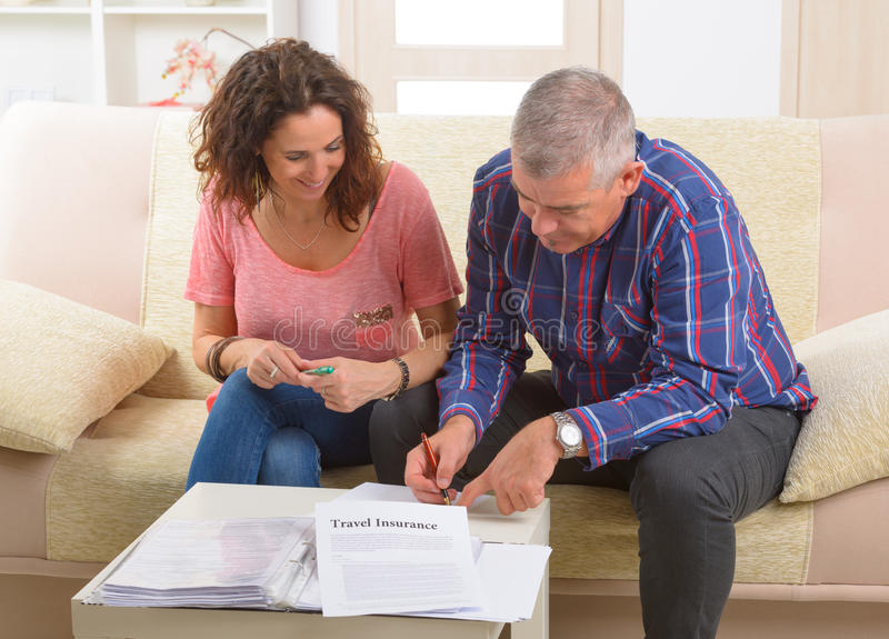 Couple signing travel insurance contract royalty free stock photography