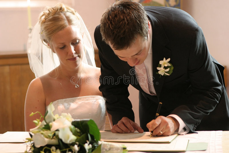 Couple Signing Wedding Marriage Register stock photos