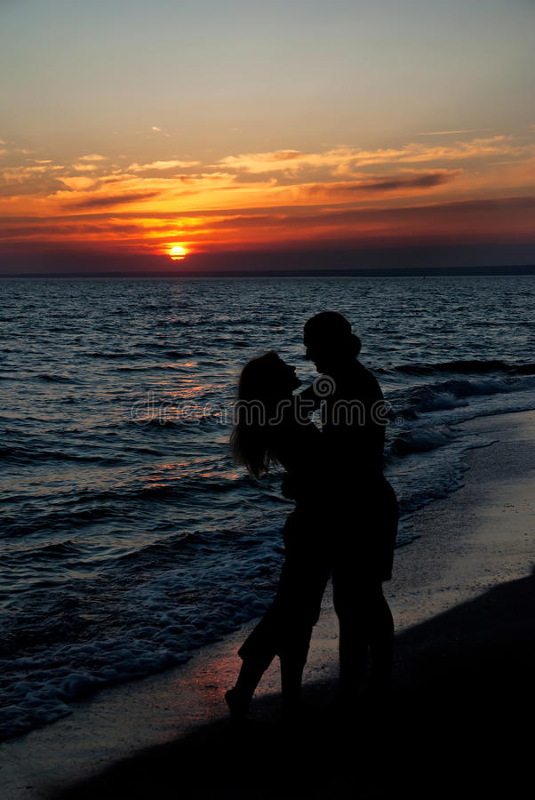 Free Couple Silhouette On Beach Against Sunset Royalty Free Stock Photography - 24023107