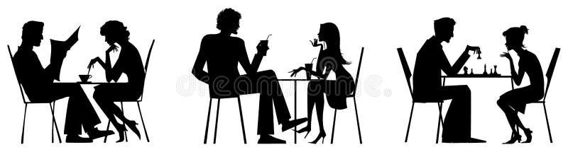 Couple silhouettes near table stock photo