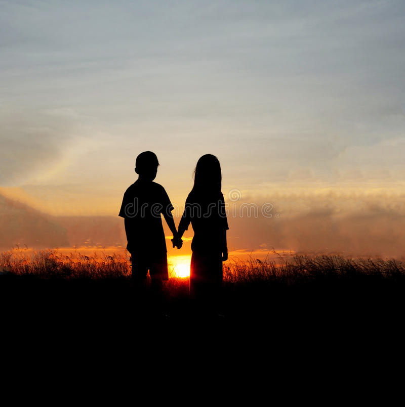 Couple silhouettes at sunset royalty free stock photography