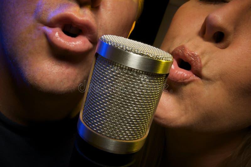 Couple Singing Duet stock photos