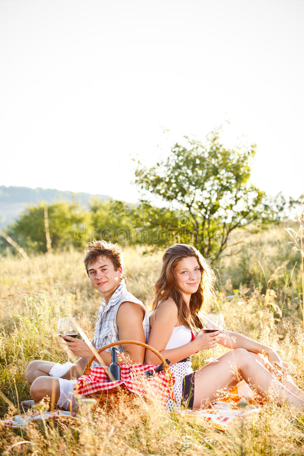 Download Couple sit on meadow stock photo. Image of outdoors, nature - 25993258