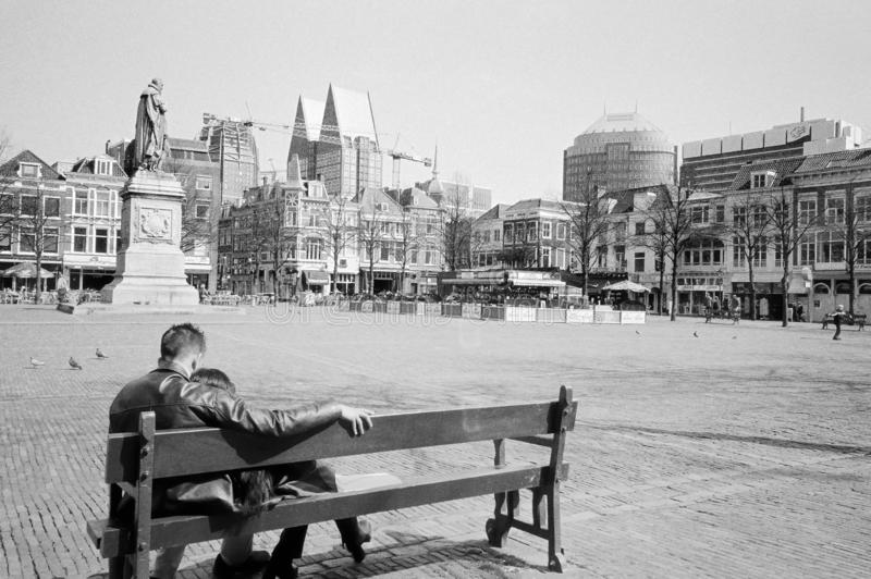 Lovers sitting on a bench. The Hague, Holland. stock photo