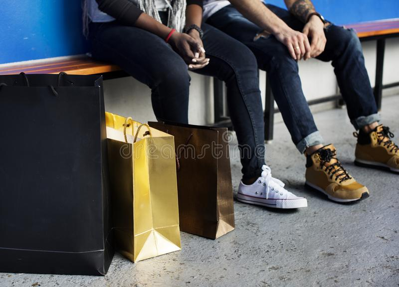 Couple sitting after finishing with shopping stock photos