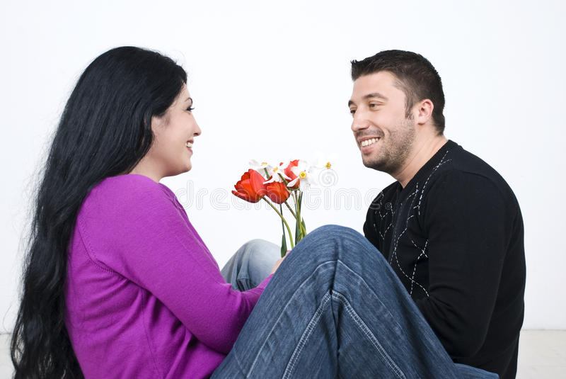 Couple sitting on floor and laughing stock photography