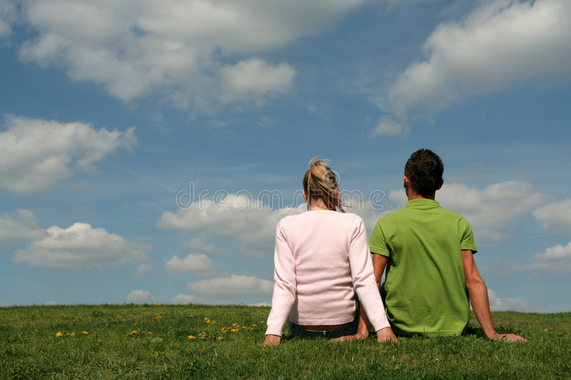 Download Couple Sitting On The Grass Stock Photo - Image: 775492