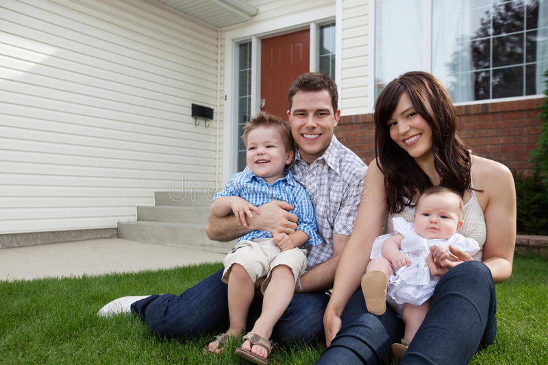 Download Couple Sitting On Grass With Their Children Stock Photo - Image: 22212098
