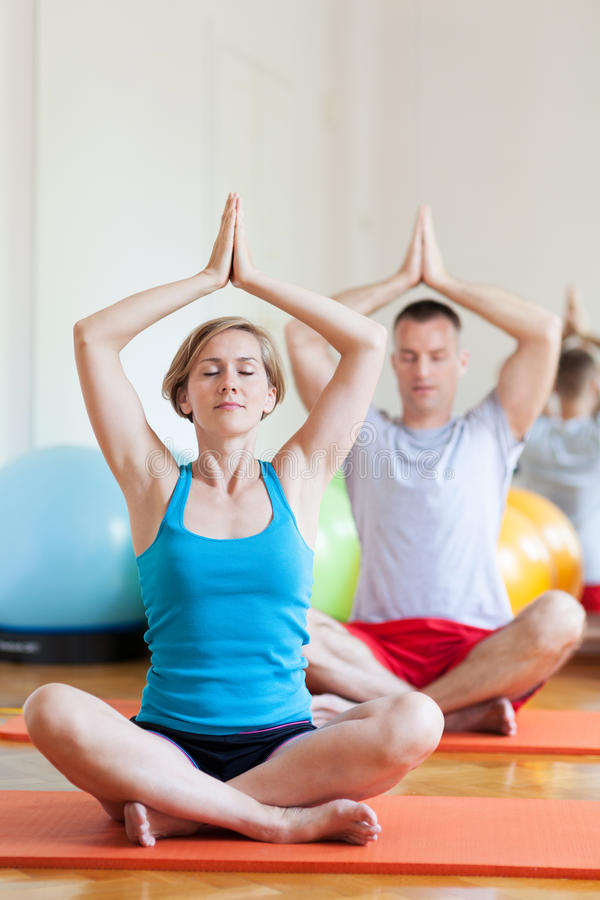 Couple sitting in lotus position royalty free stock photo