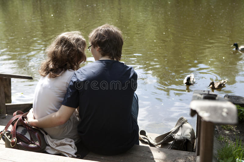 Download A Couple Sitting Near River Stock Photography - Image: 14442202