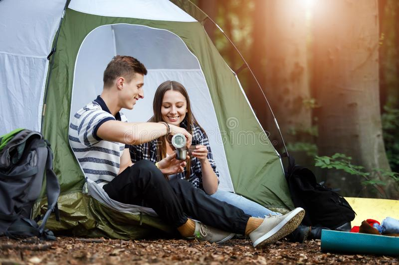 Couple Sitting Near the Tent royalty free stock images