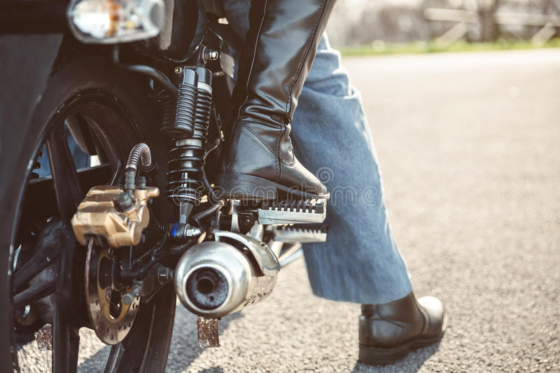 Couple sitting over motorcycle ready to go stock images