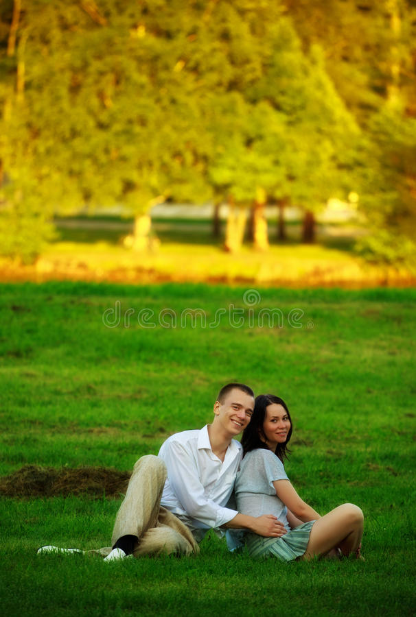 Download Couple Sitting On Park Lawn Stock Photo - Image of love, happy: 16155764