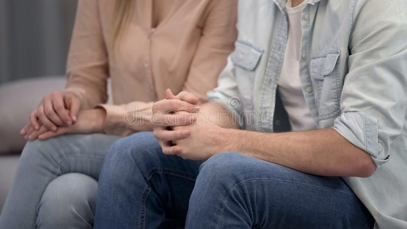 Couple sitting at psychologist, family crisis therapy, marriage counseling royalty free stock photography