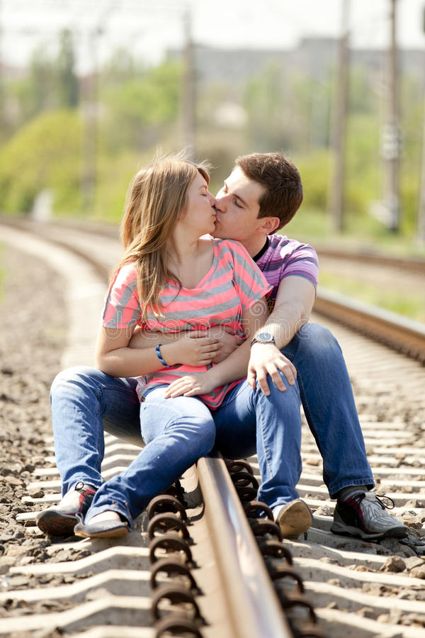 Download Couple Sitting At Railway. Stock Photography - Image: 24606662
