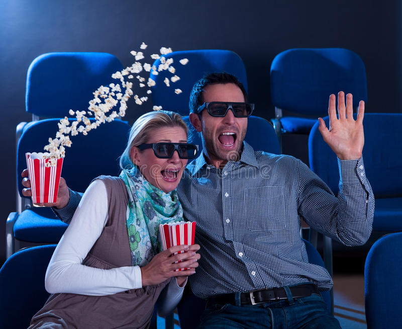 Couple reacting in shock to a 3D movie royalty free stock photography