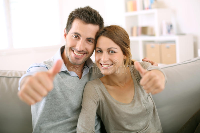 Download Couple Sitting In Sofa With A Positive Look Stock Image - Image: 31545661