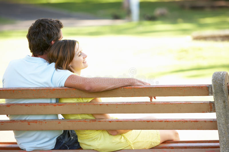 Download Couple Sitting Together On Park Bench Stock Image - Image: 14640423