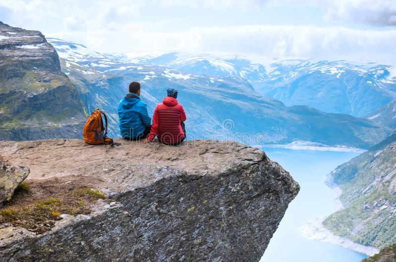 Couple sitting view on the way to Trolltunga, Norway Concept of freedom and success stock photo