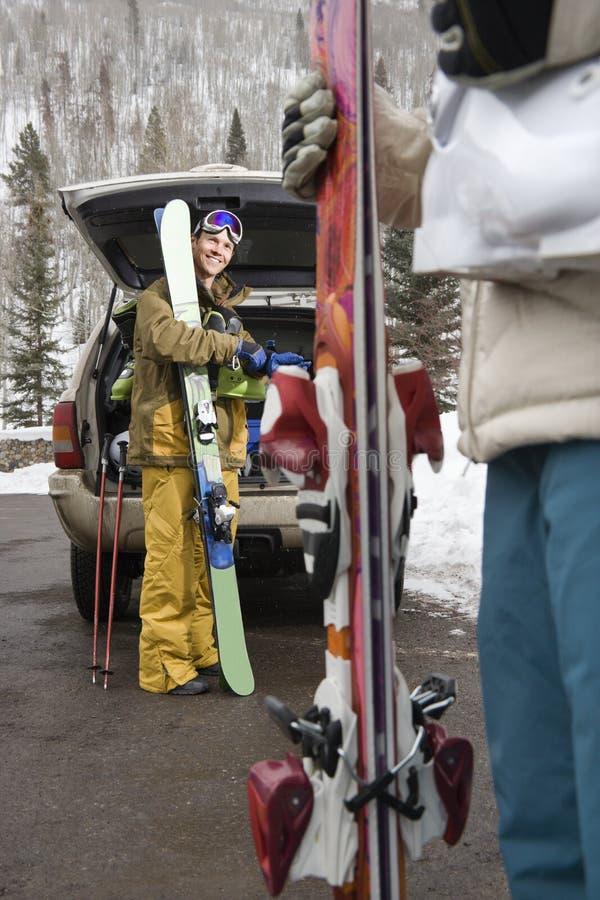 Couple with ski equipment. stock photo