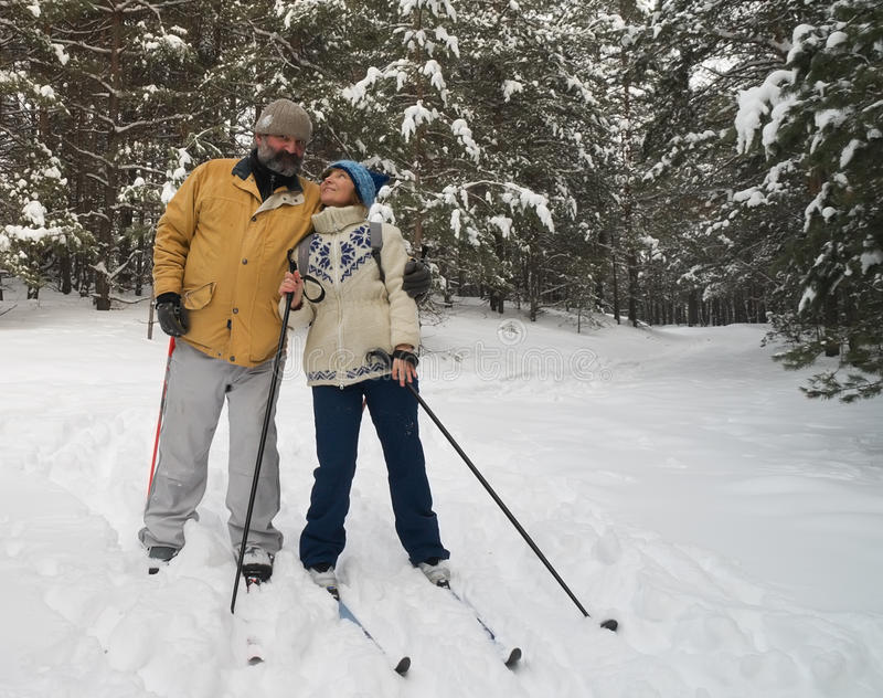 Couple on a ski outing. A pair of middle age on a ski outing stock image