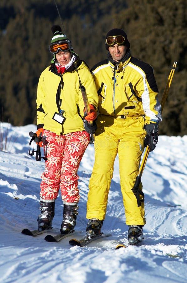 Couple skiers on mountain ski elevator stock photos