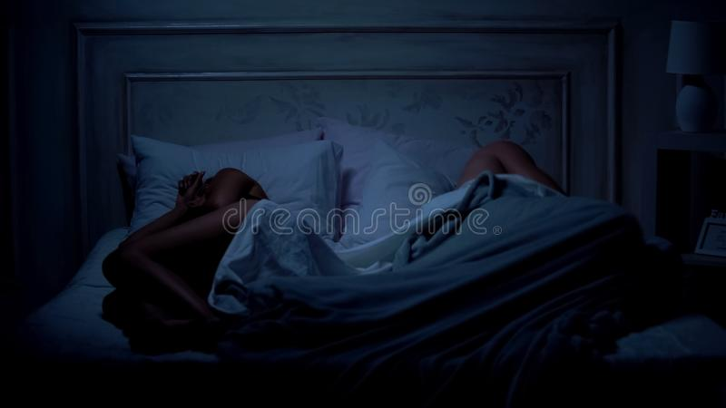 Couple sleeping in bed, lying apart, relations difficulties, quarreling concept. Stock photo royalty free stock photo