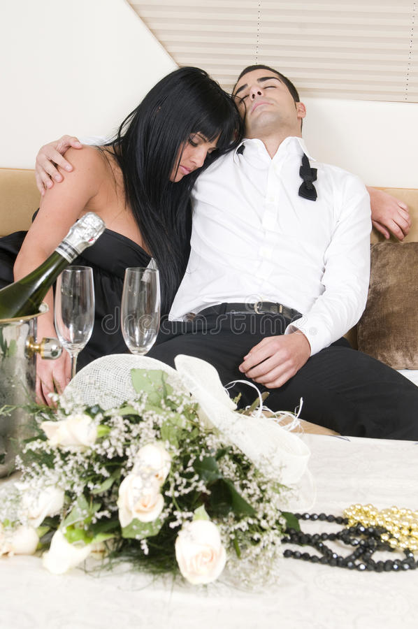 Couple sleeping after new year party. Couple sleeping tired after new year party royalty free stock photos