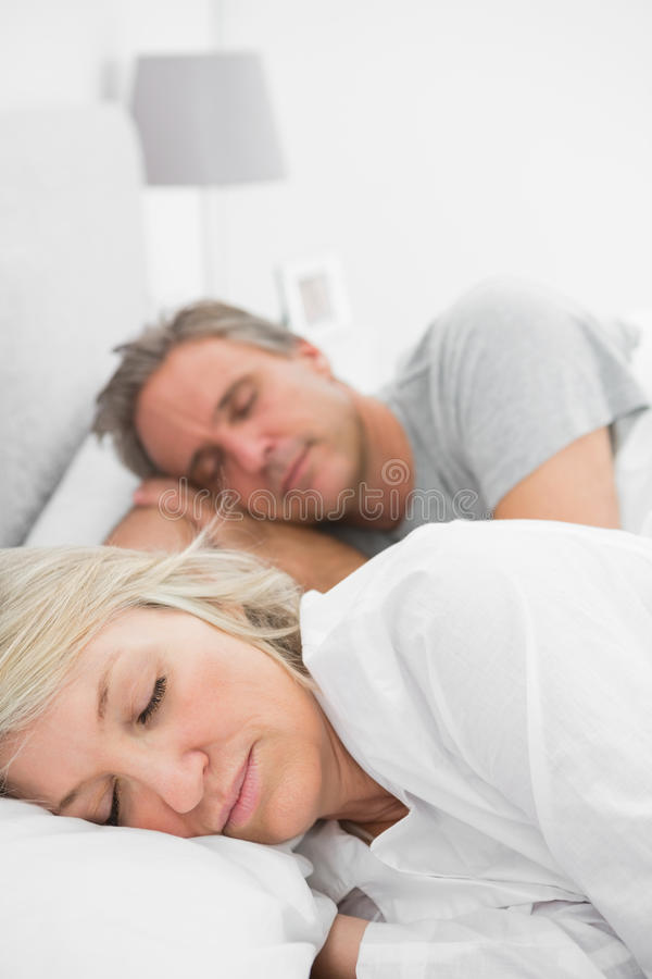 Couple sleeping peacefully stock photography