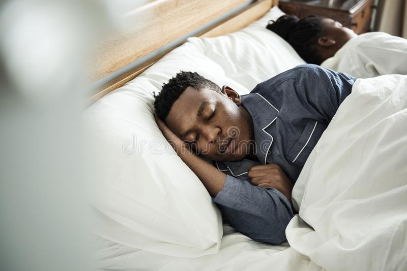 Couple sleeping soundly in bed stock photography