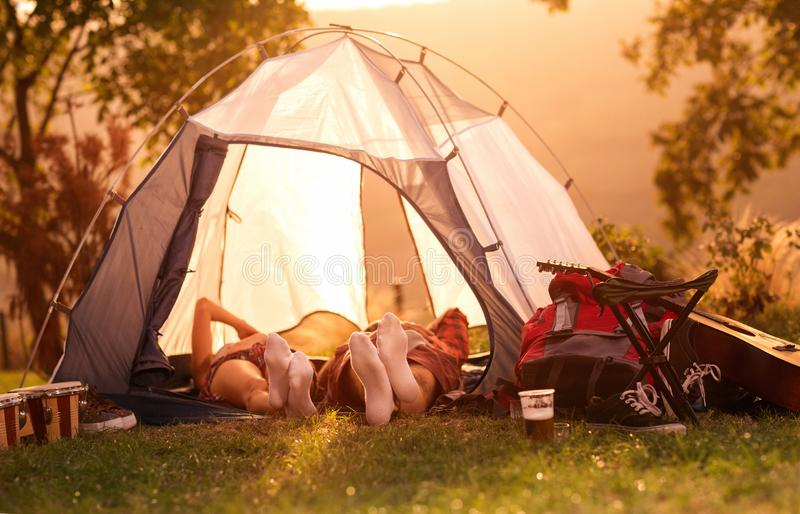 Couple sleeping in tent at early morning. Couple sleeping in tent at early morning sun royalty free stock images