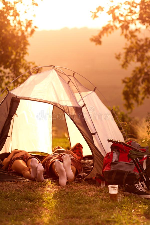 Couple sleeping in tent. Couple sleeping in tent in their campsite at a music festival royalty free stock photo