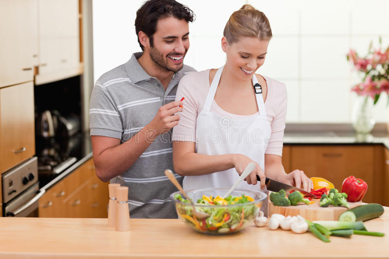 Download Couple slicing vegetables stock image. Image of home - 22235179