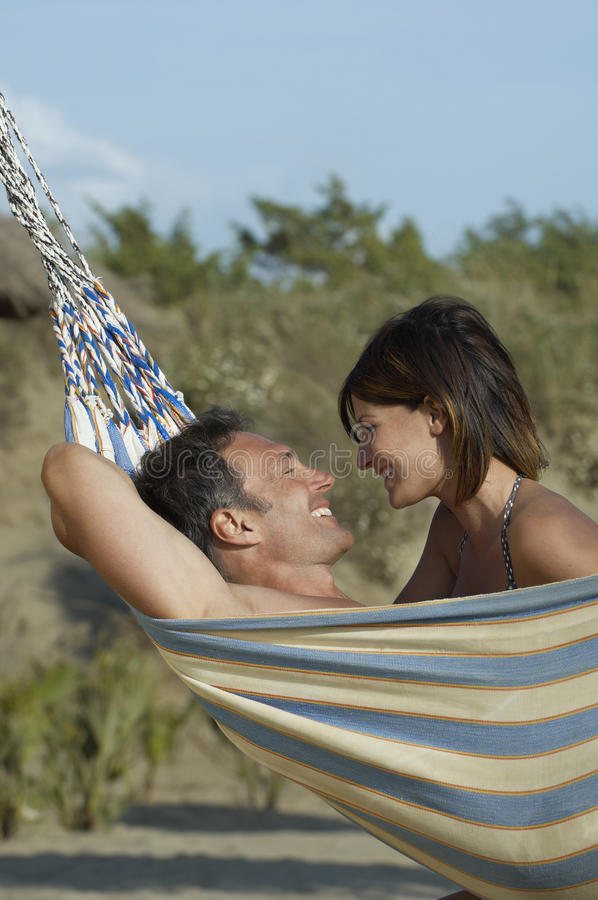 Couple Smiling In Hammock royalty free stock photos