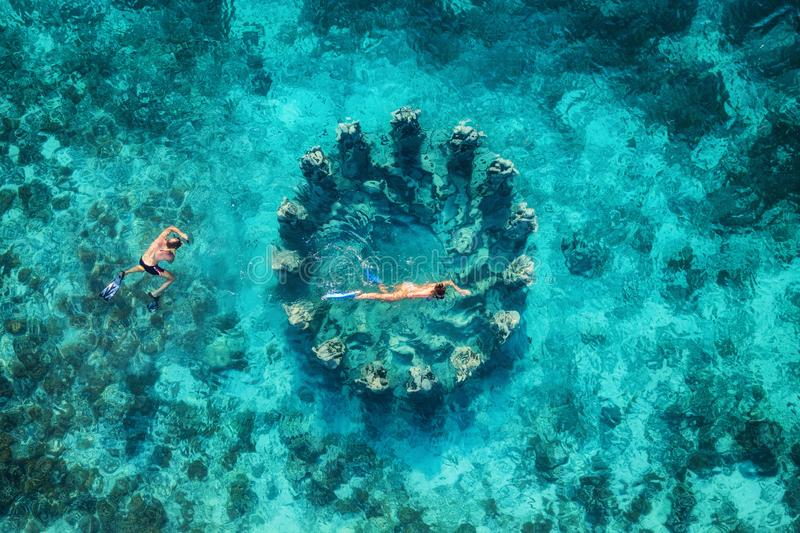 The couple snorkeling near the famous place on Gili Meno Island, Indonesia. Aerial view from drone. Underwater tourism in the ocea. N. Vacation and adventure stock photos