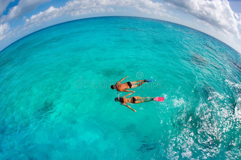 Couple snorkling. Couple snorkeling in turquoise waters on tropical vacation