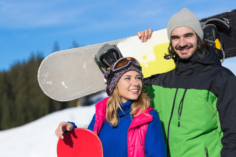 Couple With Snowboard Ski Resort Snow Winter Mountain Smiling Man And Woman Extreme Sport Vacation. Holiday royalty free stock images