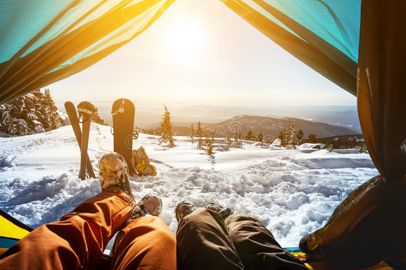 Couple of snowboarder and skier in tent royalty free stock photos