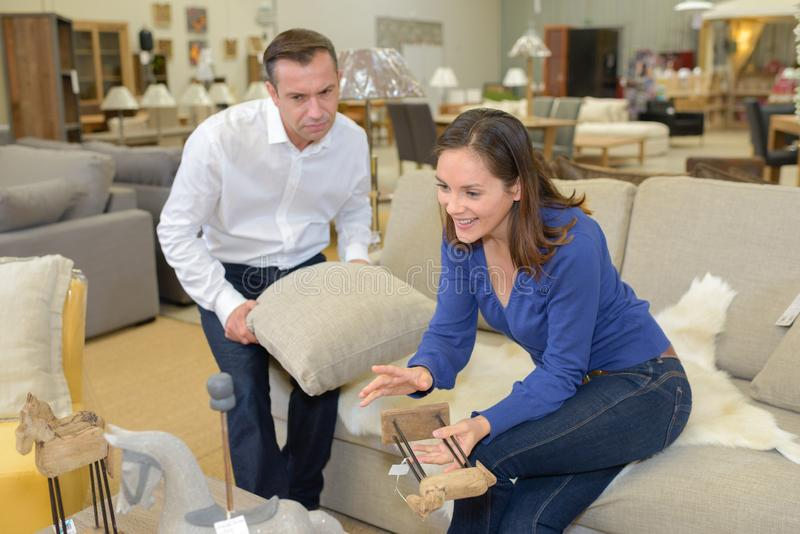 Couple in sofa furniture store royalty free stock photography