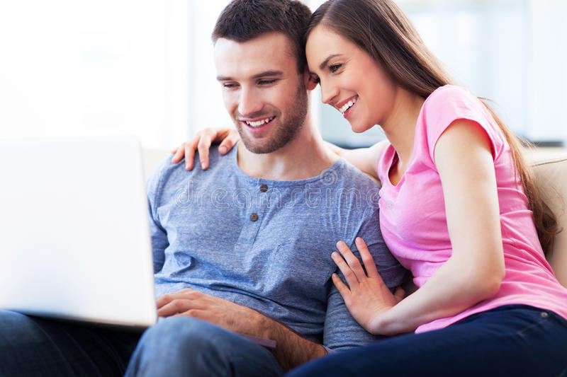 Download Couple on sofa with laptop stock photo. Image of hugging - 30843174