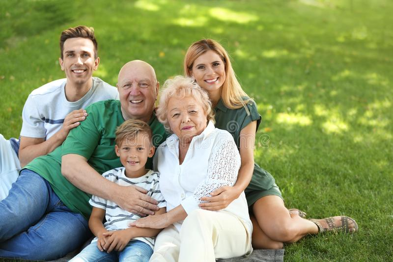 Couple with son and elderly parents stock images