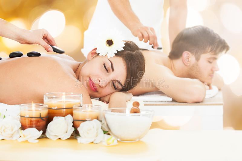 Couple In A Spa Getting Hot Stone Therapy stock photos