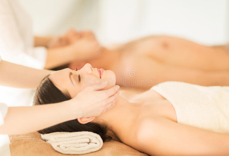 Couple in spa. Picture of couple in spa salon getting face treatment stock photos