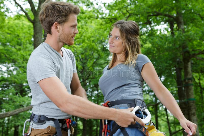 Couple spend their leisure time in ropes course. Couple spend their leisure time in a ropes course royalty free stock image