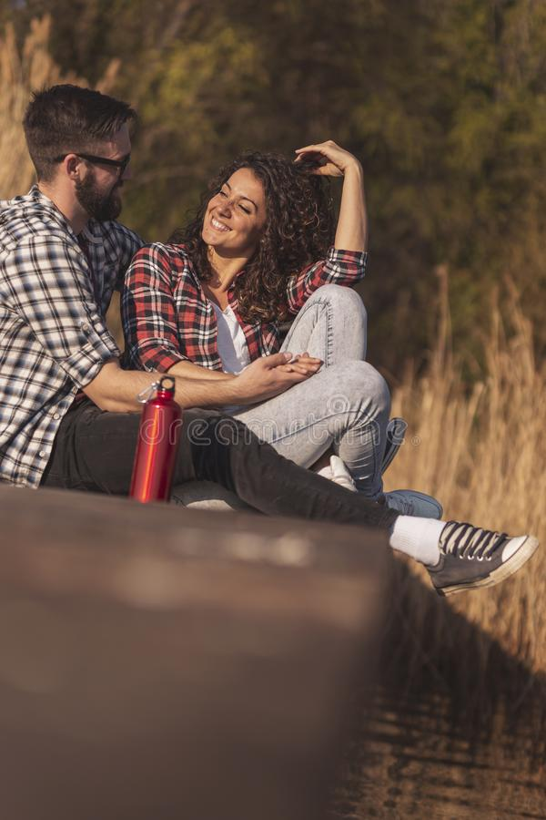 Couple spending autumn day in nature royalty free stock photo