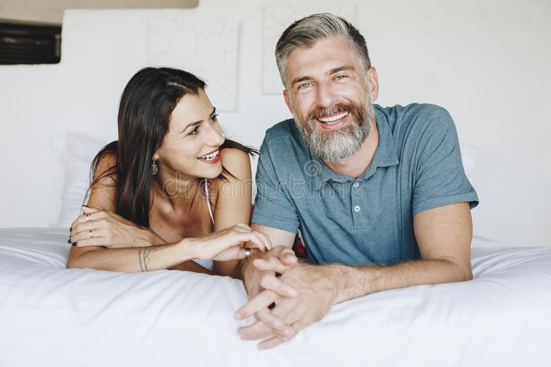 Couple spending their honeymoon in bed stock images