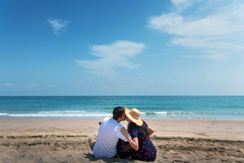 Couple spending time on the beach with a guitar royalty free stock photo